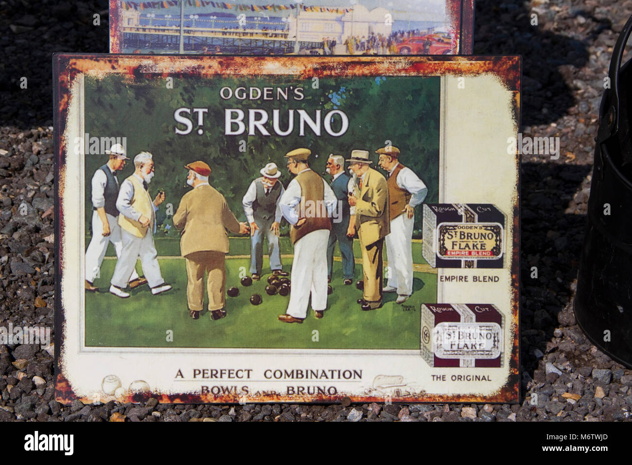 Stove enamel advertising sign for St Bruno pipe tobacco showing a bowls match - Stock Image