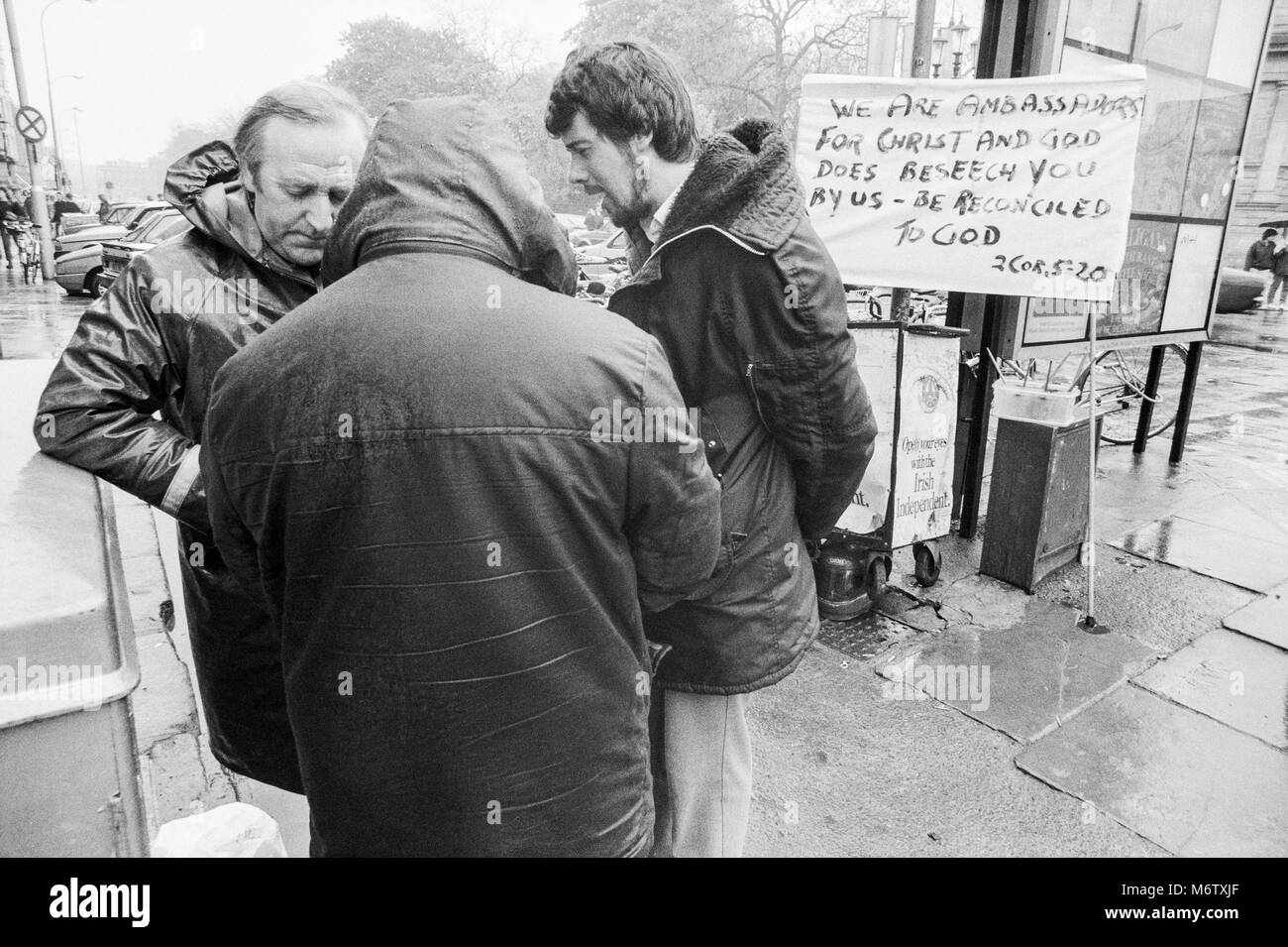 Three men preaching in the street at St Stephens Green, Dublin City Center, Ireland, Archival photograph from April - Stock Image