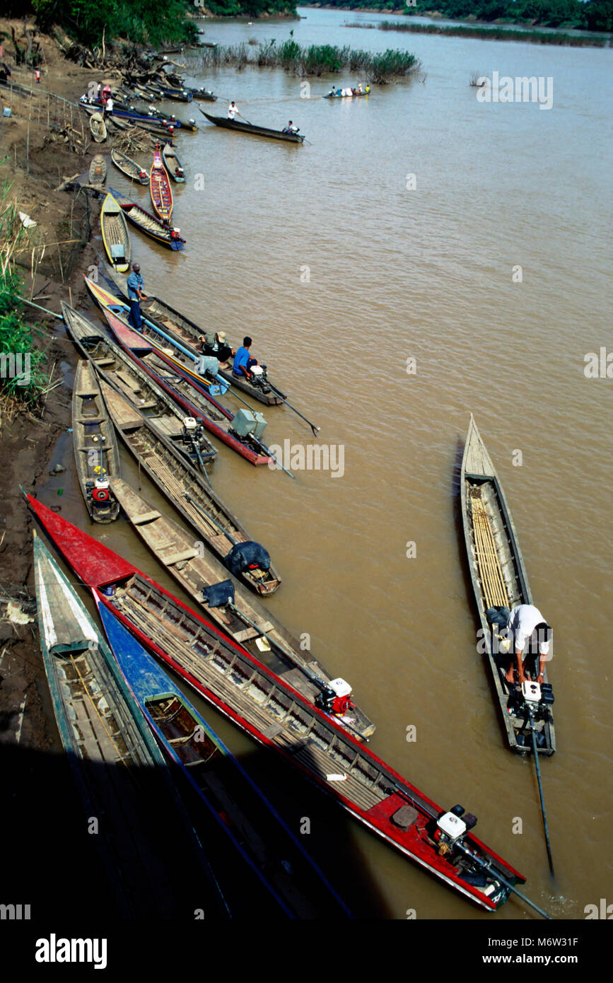 Transportation by boat along the Mekong river is the economic lifeblood in Laos. - Stock Image