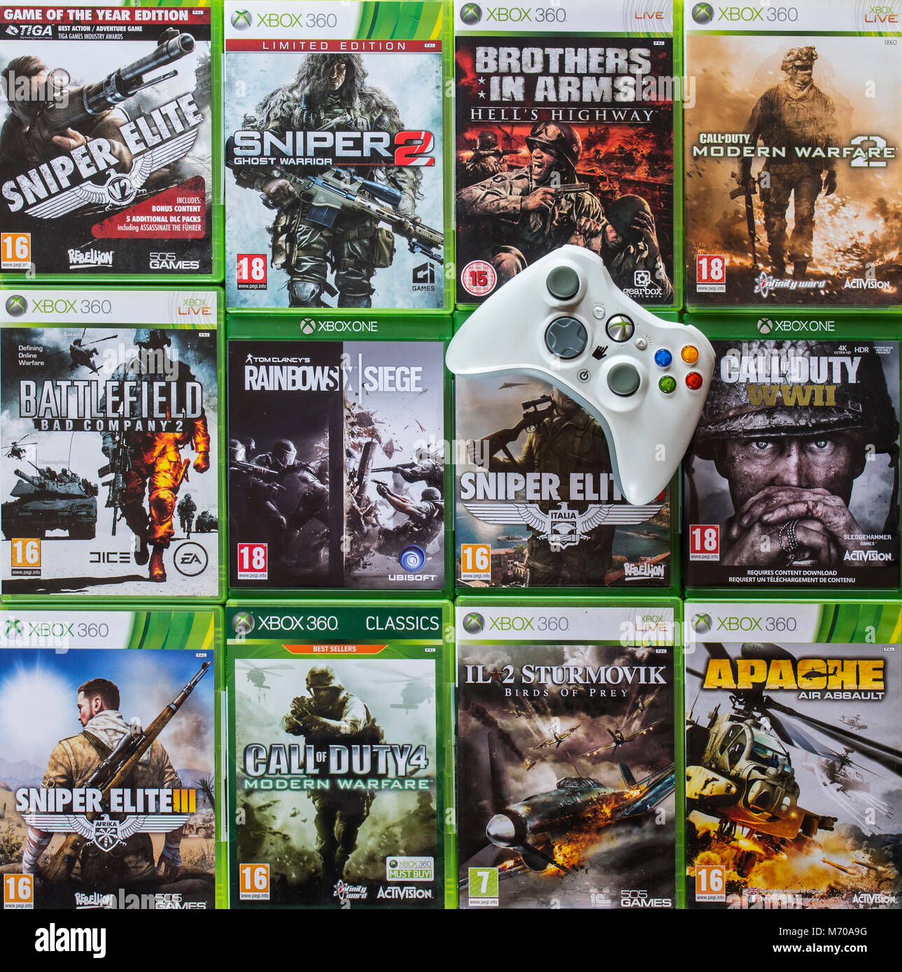 Controller and collection of violent first-person shooter video games for Xbox 360 and Xbox One - Stock Image