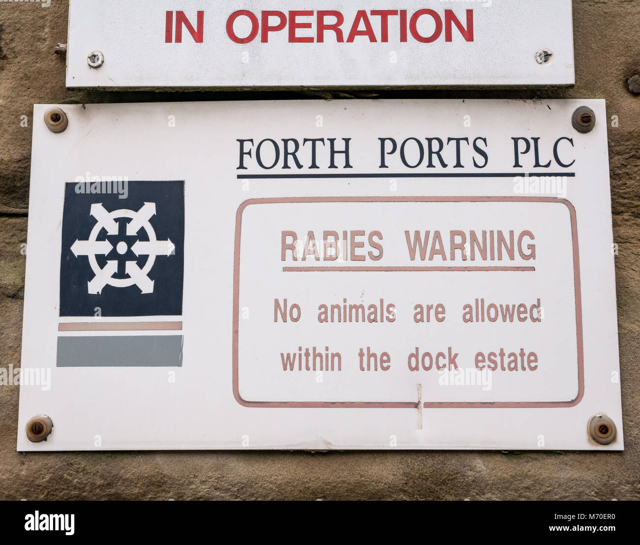 Close up of Forth Ports entrance sign warning about rabies, Leith Dock, Edinburgh, Scotland, UK - Stock Image