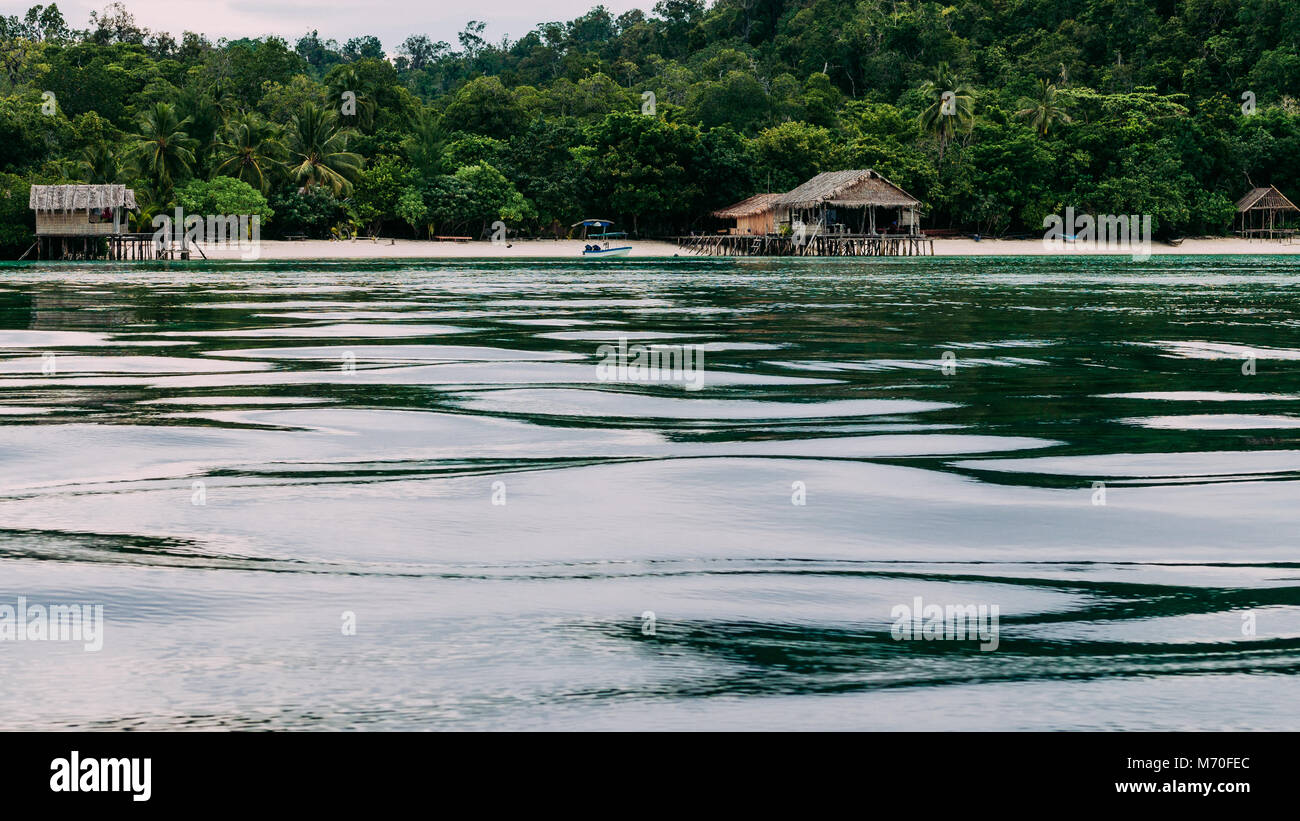 Bamboo Huts on wooden Stocks of an Homestay, Gam Island, West Papuan, Raja Ampat, Indonesia - Stock Image