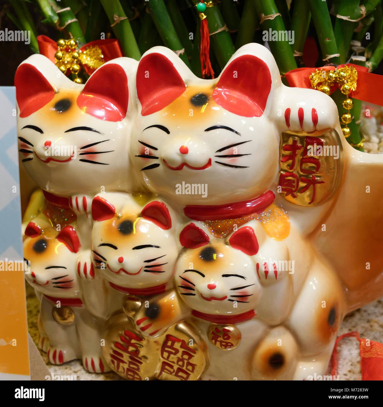 Maneki Neko lucky fortune cats on display at a restaurant - Stock Image