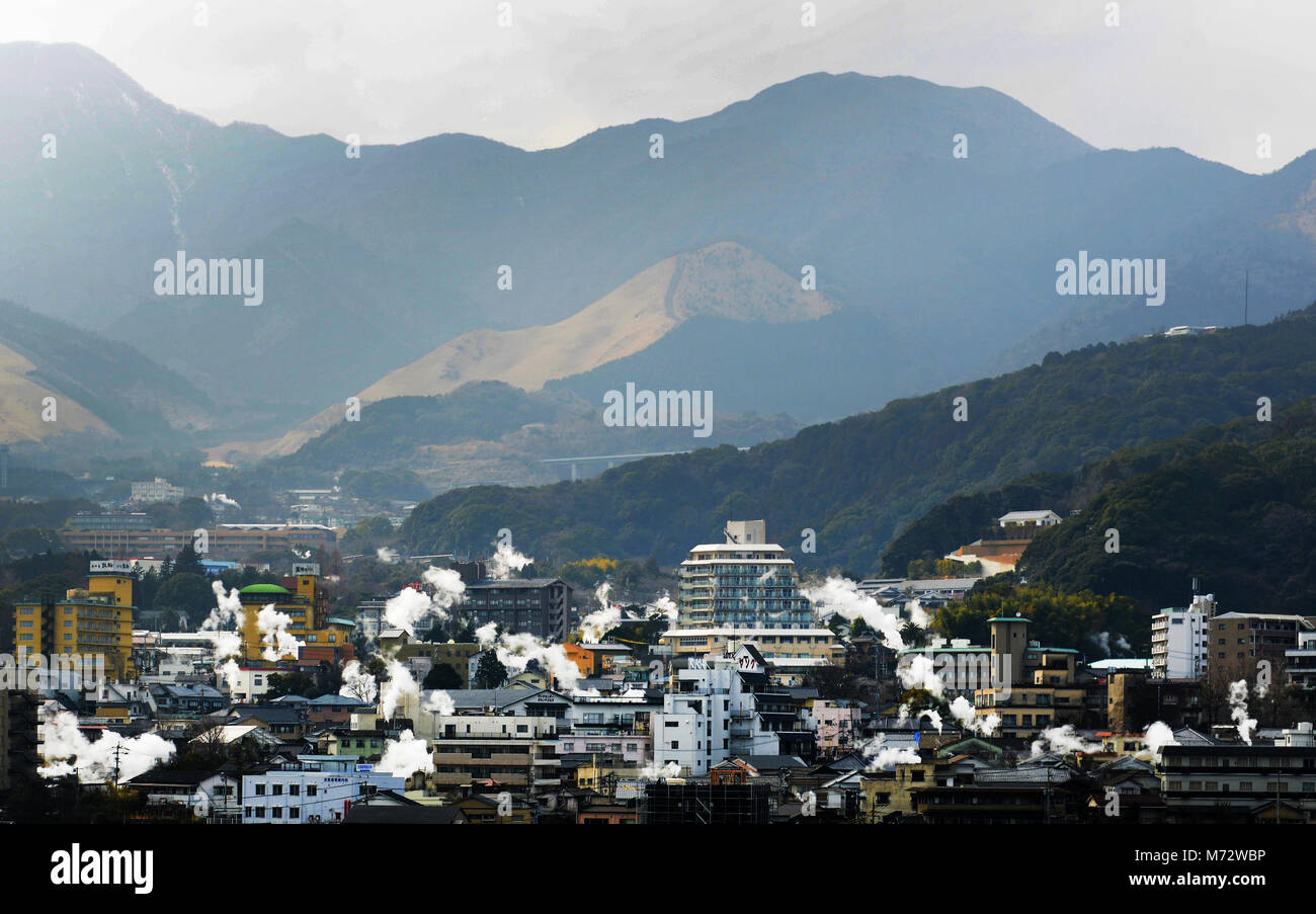 Hot spring steam rising everywhere in Beppu- A famous Japanese onsen /  spa town in Kyushu, Japan. - Stock Image