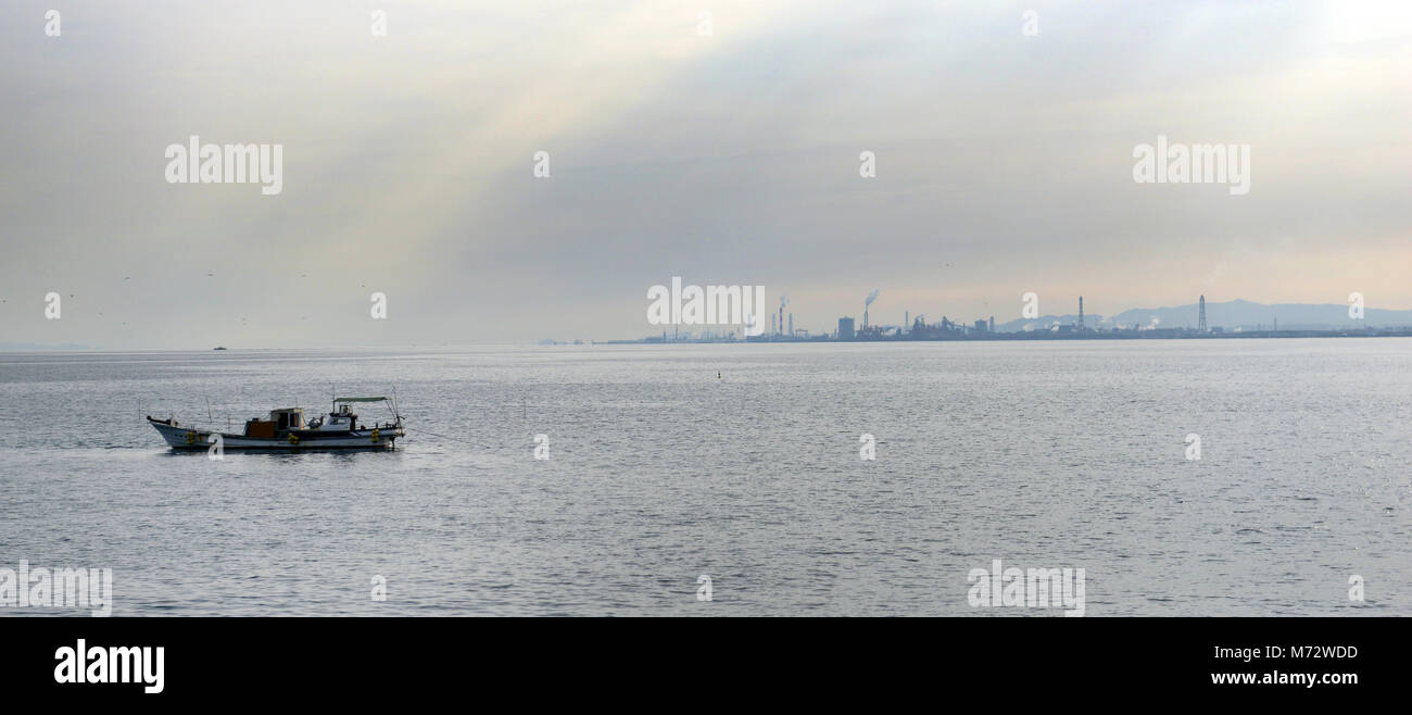 fishing boats with the Oita port in the background. - Stock Image