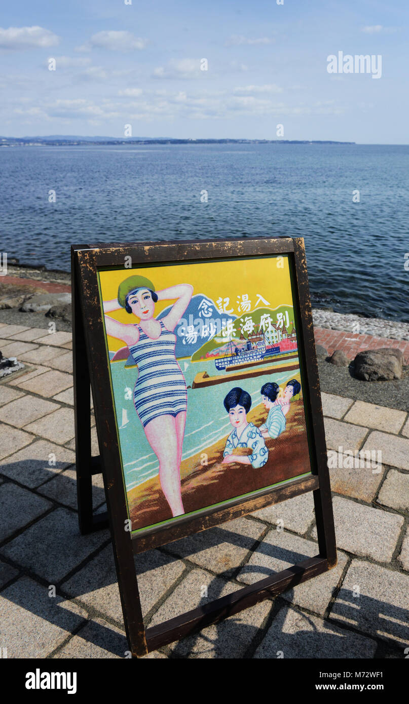 An old sign advertising the sand bath at Kamegawa onsen by the ocean at Beppu. - Stock Image