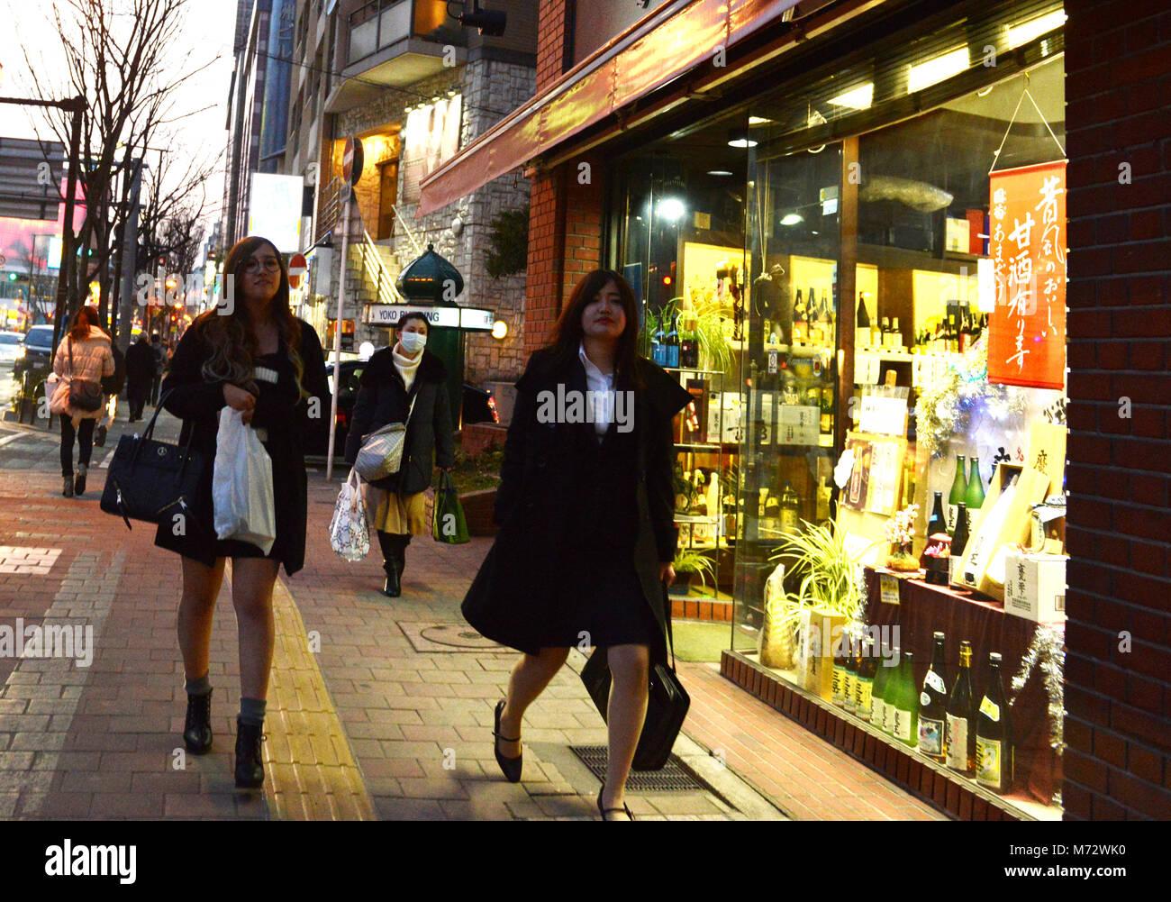 Japanese women walking along Ginomachi  street in Fukuoka. - Stock Image