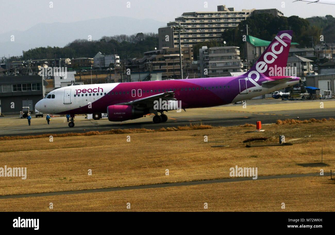 A Peach airlines aircraft at Fukuoka airport in Japan. - Stock Image