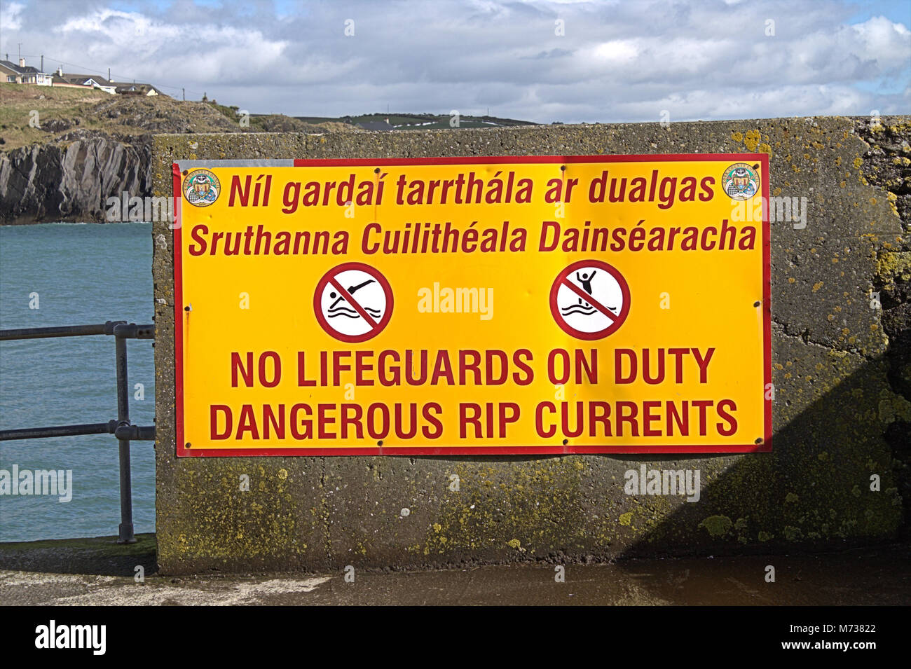danger-rip-tides-sign-in-english-and-gaelic-the-sign-is-at-the-end-M73822.jpg