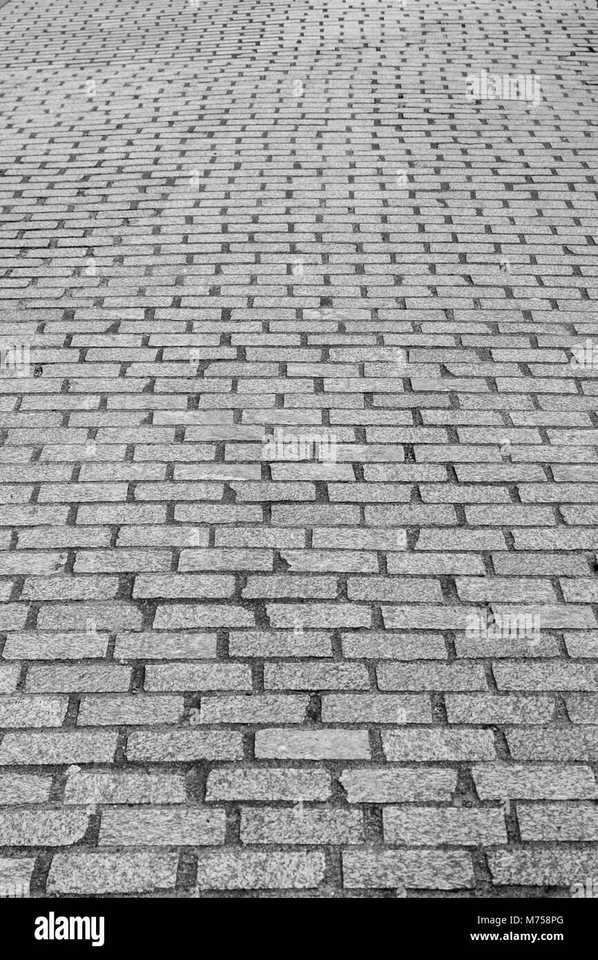 Cobblestone street / area in sunshine. - Stock Image