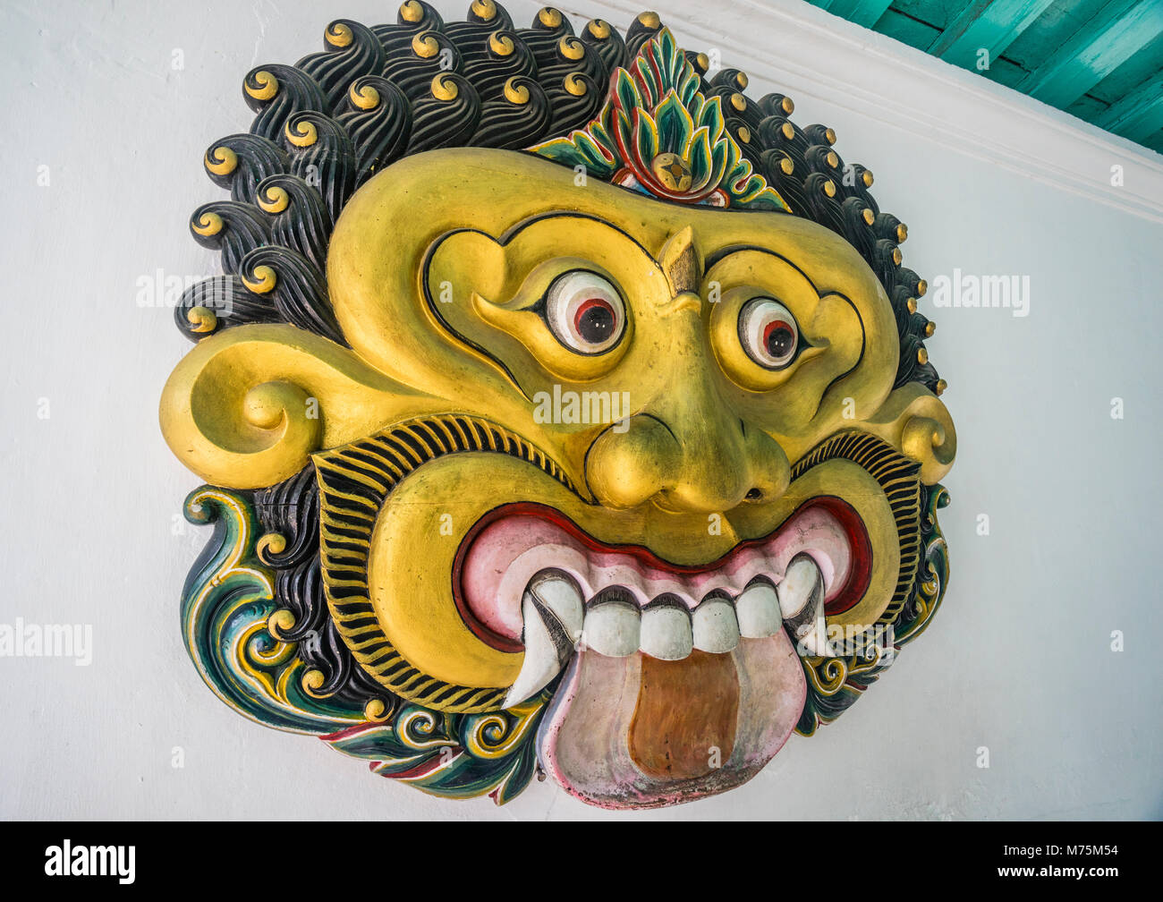 Batara Kala face, in Javanese mythology the the creator of light and earth and the god of destruction at the Kraton - Stock Image