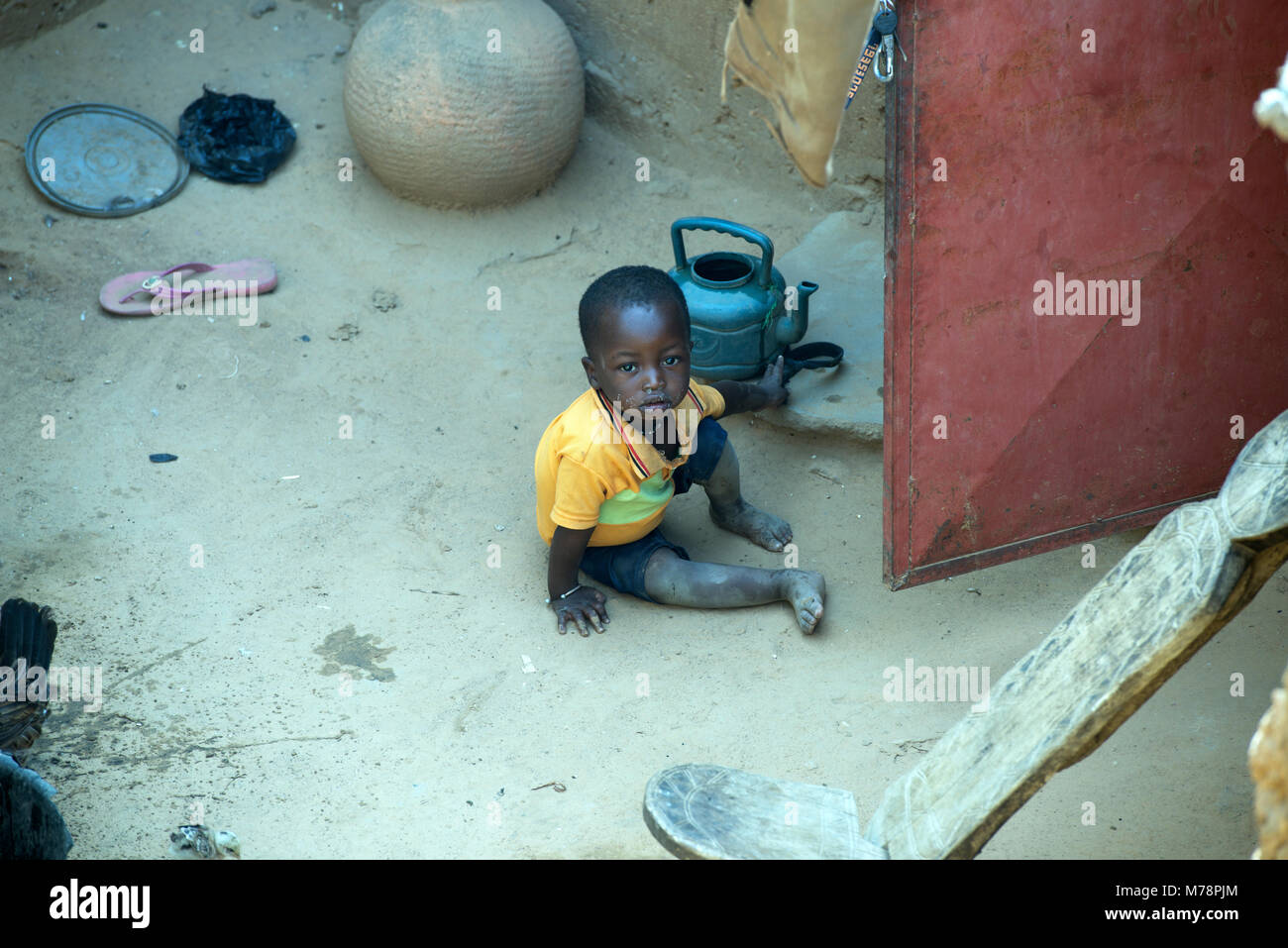 A young, indigenous Dogon boy living in poverty in a village in Dogon country, Mali, West Africa. - Stock Image