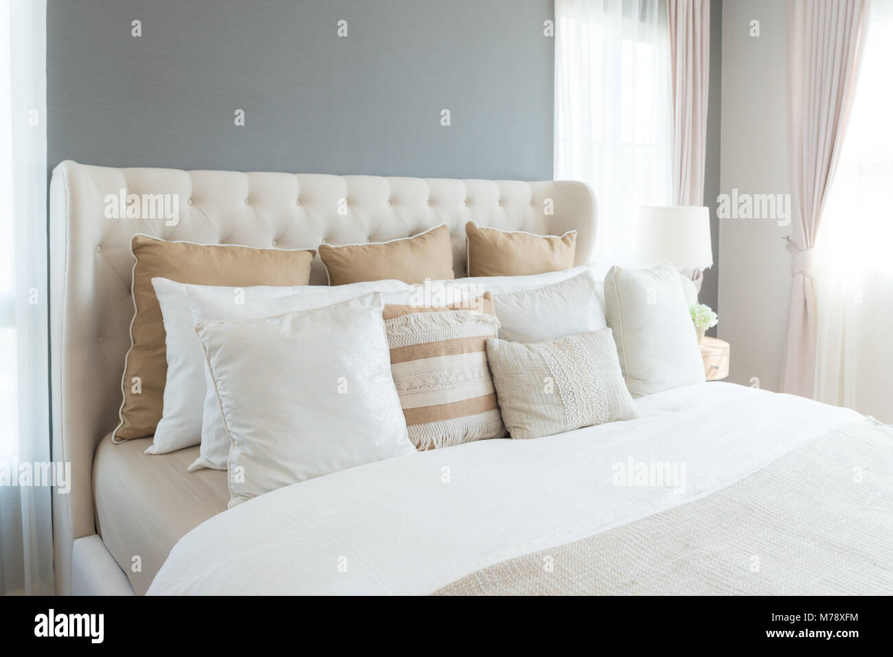 Bedroom In Soft Light Colors. Big Comfortable Double Bed In Elegant Classic  Bedroom At Home