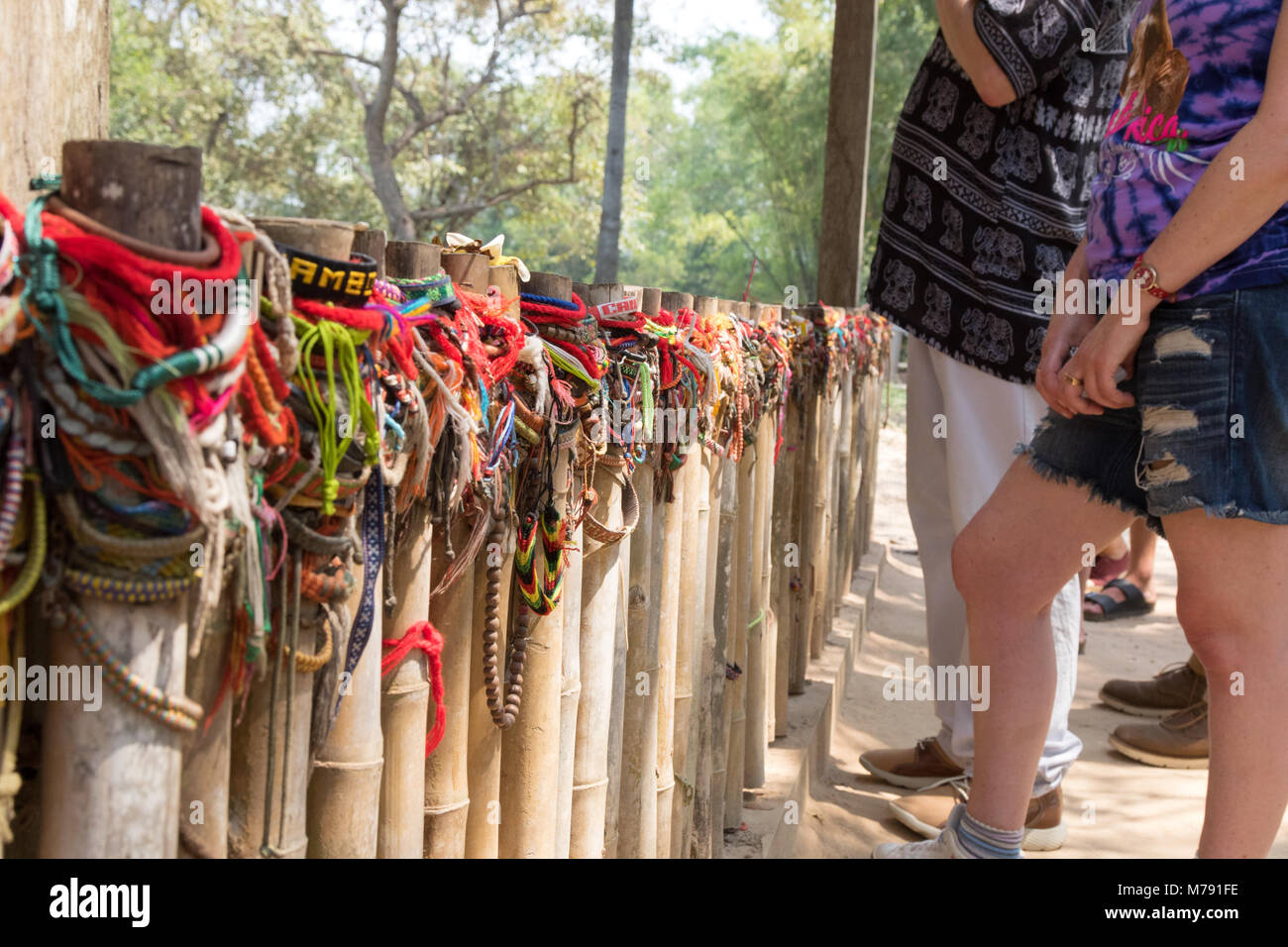 cambodia-killing-fields-colourful-memorial-ribbons-tied-around-the-M791FE.jpg