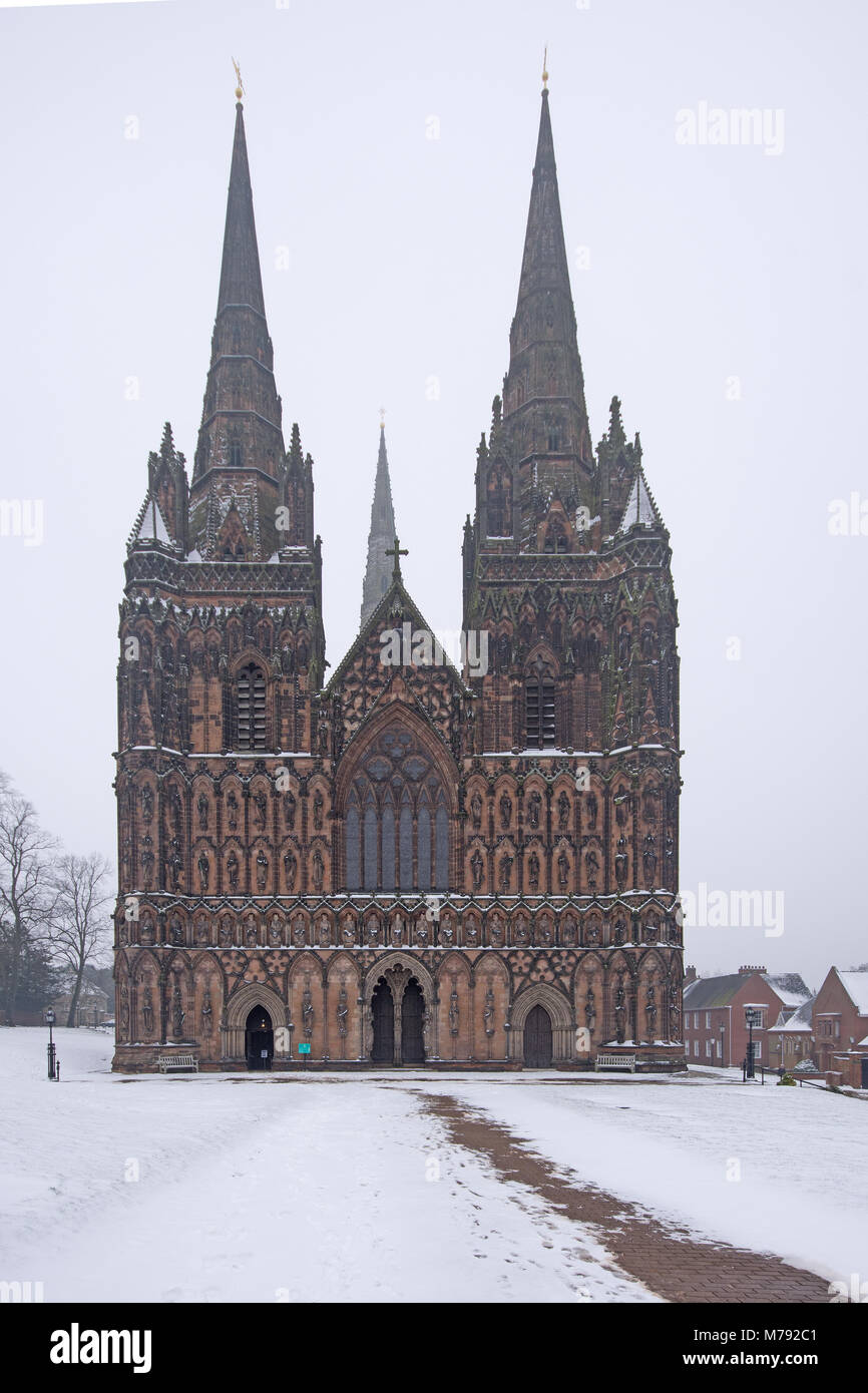 West front of Lichfield Cathedral showing the three spires on a snowy day in Lichfield Staffordshire England - Stock Image