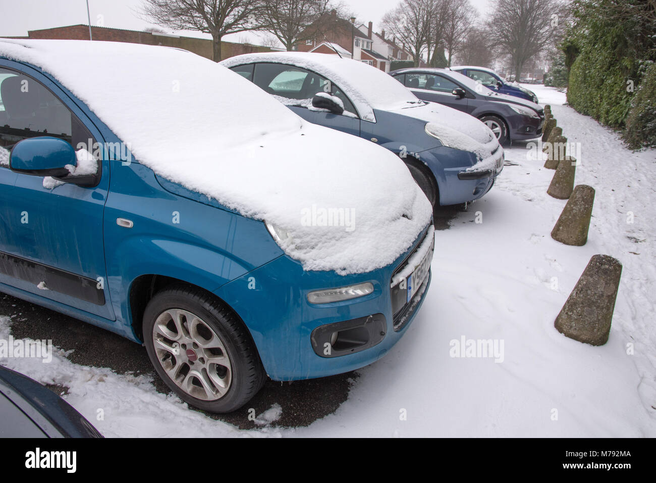 Cars covered with snow parked on Anson Avenue Lichfield Staffordshire England in unseasonal snowy weather on 3rd - Stock Image