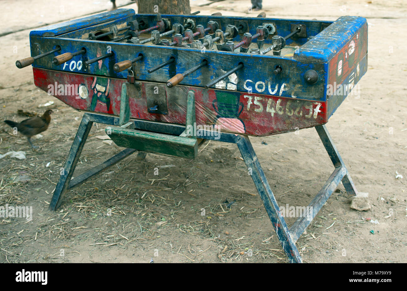A dilapidated foosball table in a small village still provides entertainment. Mopti Region, Mali, West Africa. - Stock Image