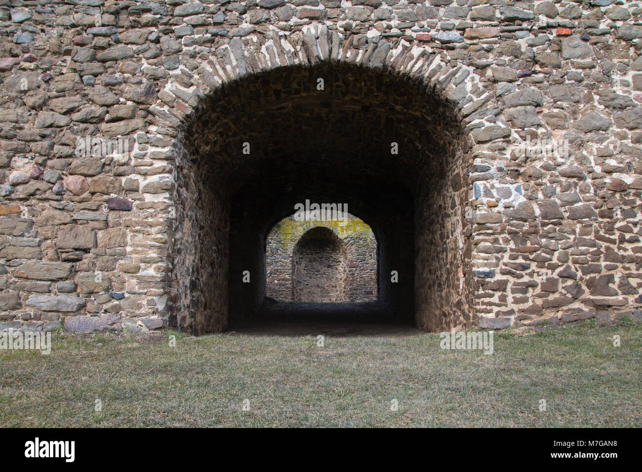 Medieval castle wall with passage, for backgrounds and textures. - Stock Image