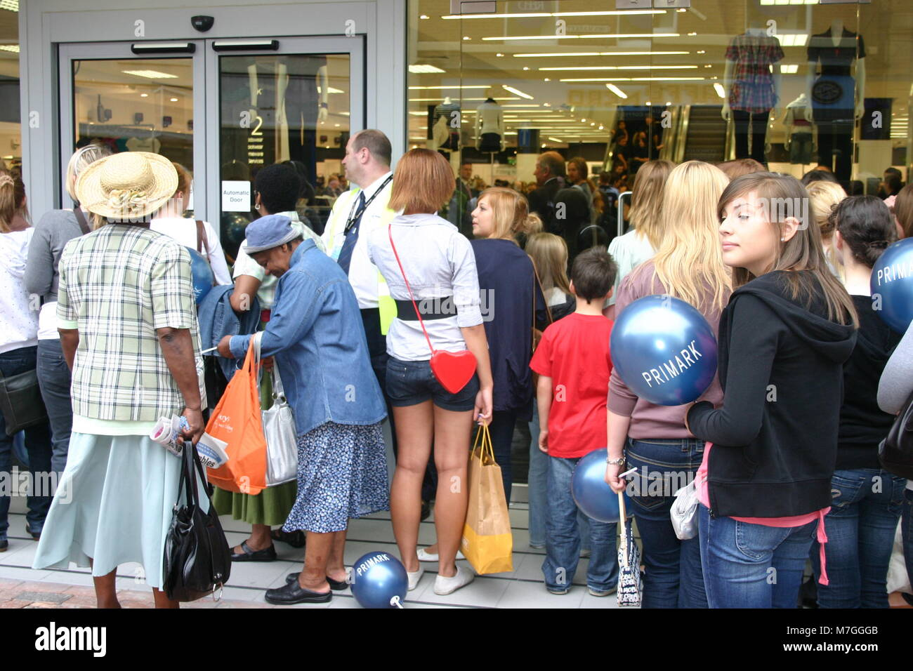The sales, with customers queuing outside Primark, Derby, UK - Stock Image