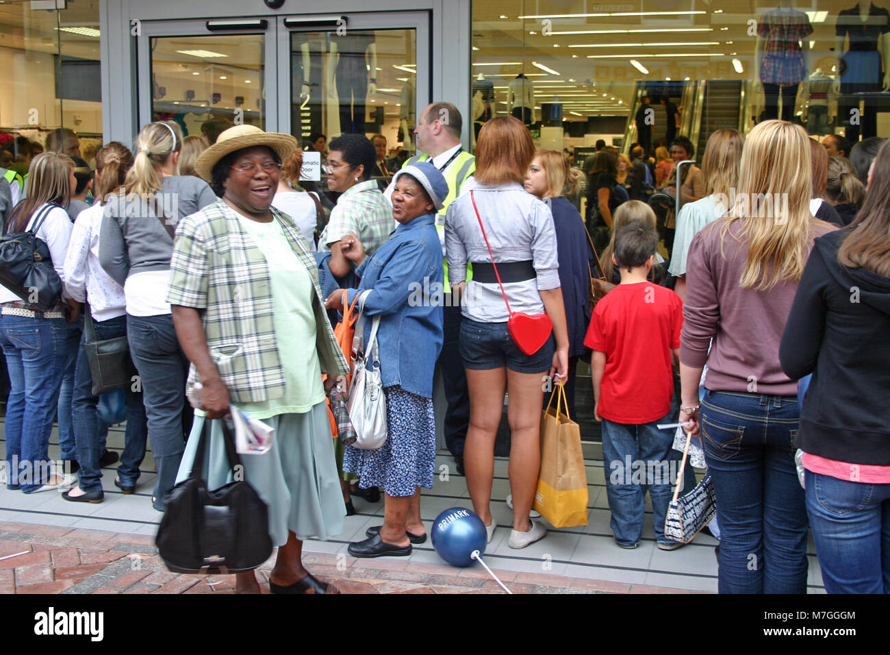 The sales, with customers queuing and rushing into Primark, Derby, UK - Stock Image
