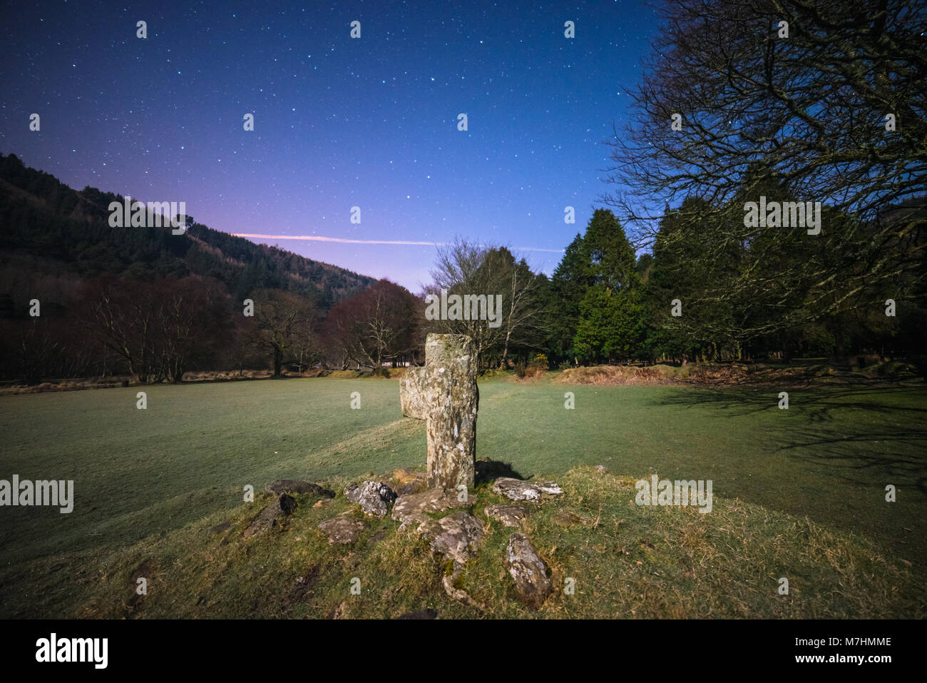 Celtic old cross in GLendalough - Ireland - Stock Image