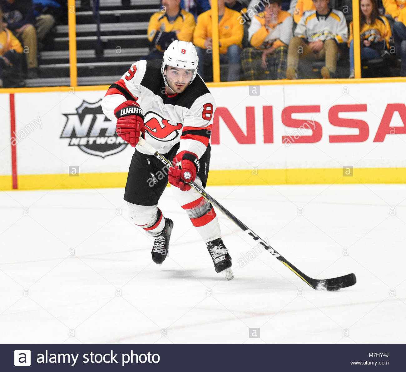 Bridgestone Arena. 10th Mar, 2018. USA New Jersey Devils defenseman Will Butcher (8) skates with the puck against - Stock Image