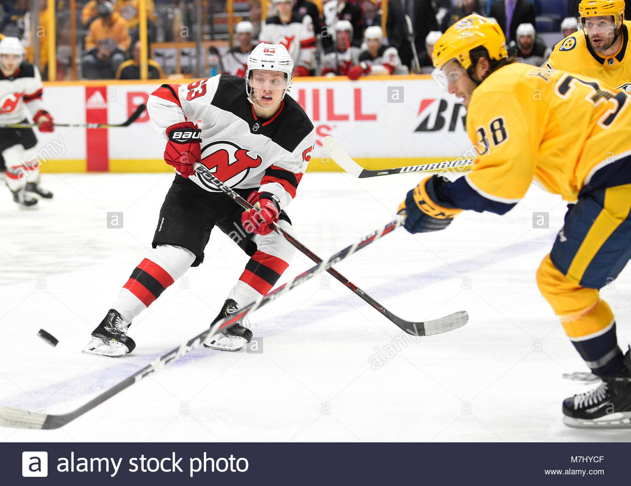 Bridgestone Arena. 10th Mar, 2018. USA Nashville Predators right wing Ryan Hartman (38) deflects the puck from New - Stock Image