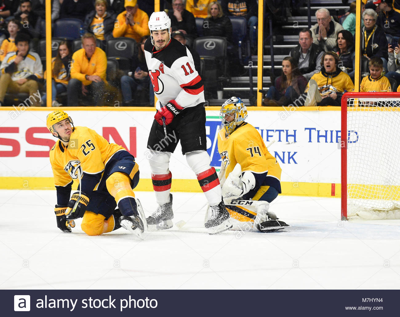 Bridgestone Arena. 10th Mar, 2018. USA New Jersey Devils center Brian Boyle (11) deflects the puck past Nashville - Stock Image