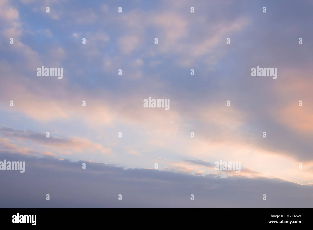 Colourful backgrounds sky overlay. Evening Morning sky with orange hues. - Stock Image
