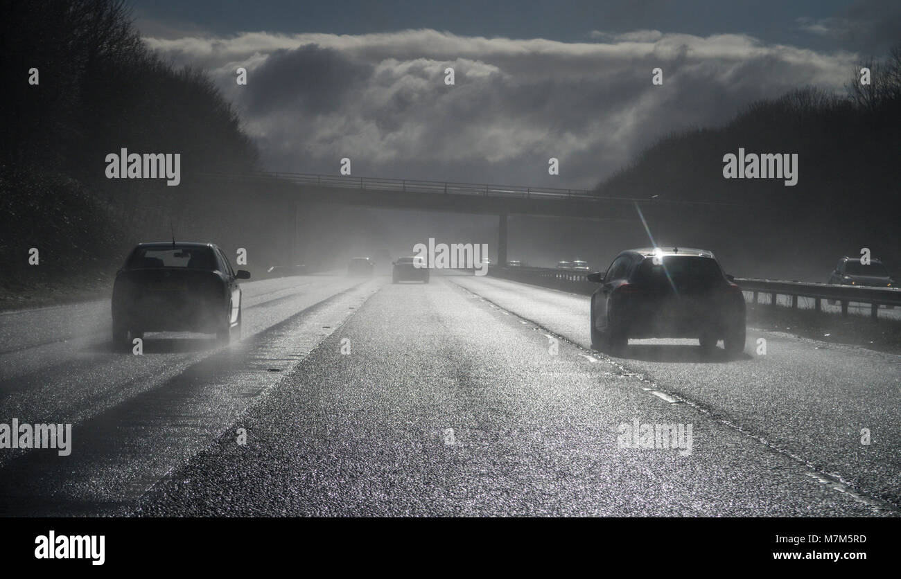 Spray from surface water on the M5 motorway creates poor visibility and dangerous driving conditions Stock Photo