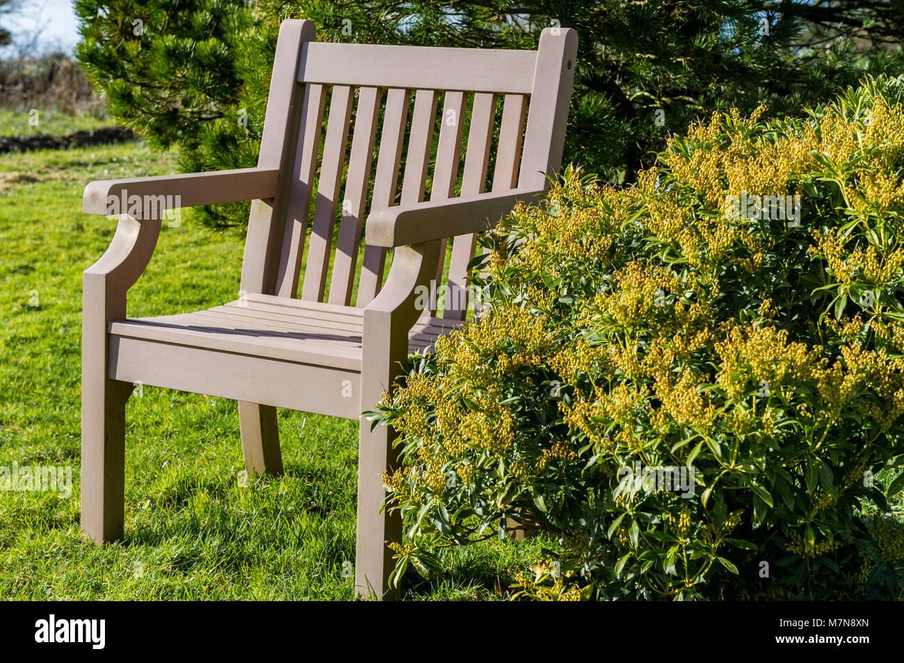 empty-wooden-chair-next-to-a-bush-in-ballydehob-west-cork-ireland-M7N8XN.jpg