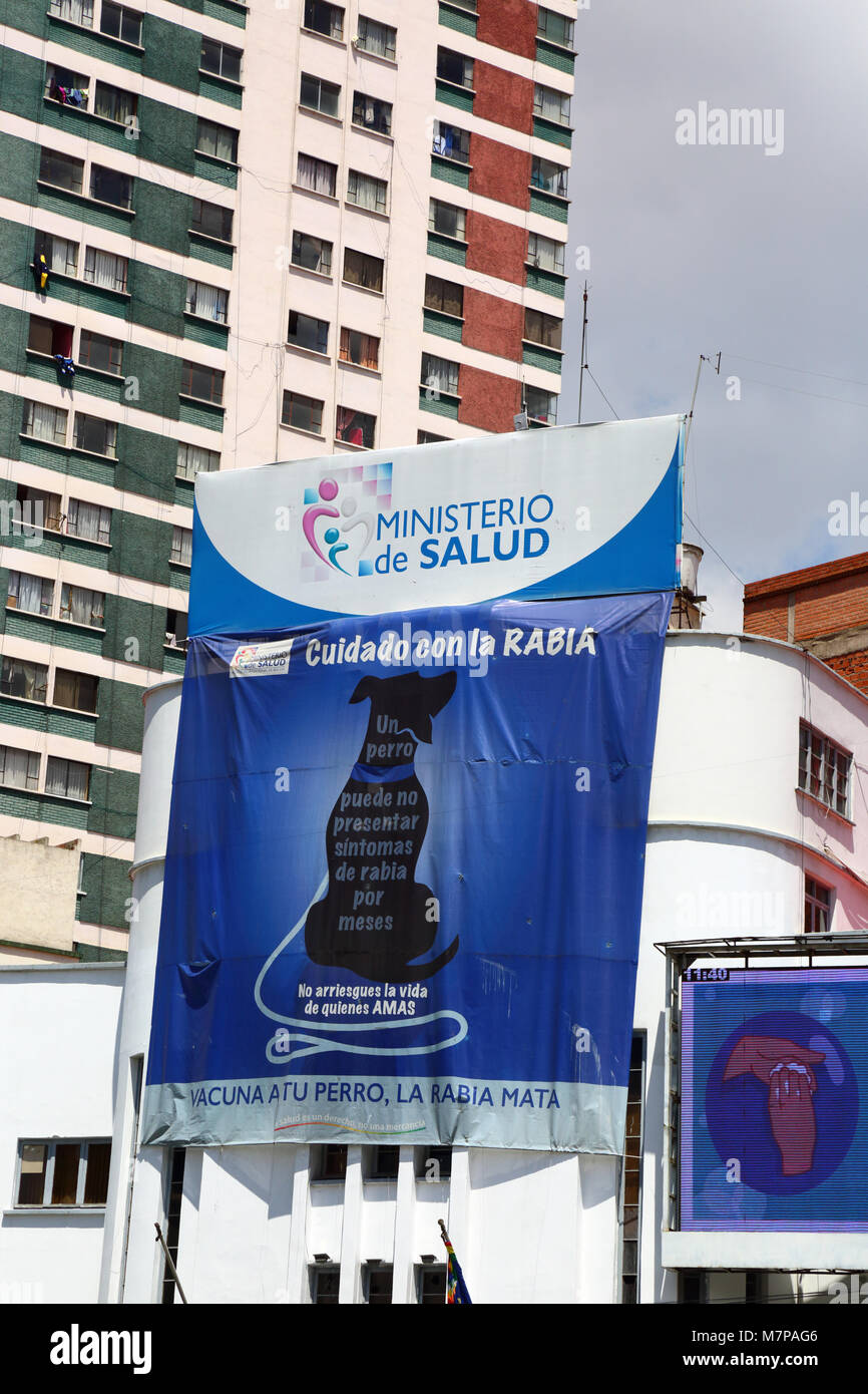 Banner on Health Ministry building in Spanish warning against rabies and encouraging people to vaccinate their dogs, - Stock Image