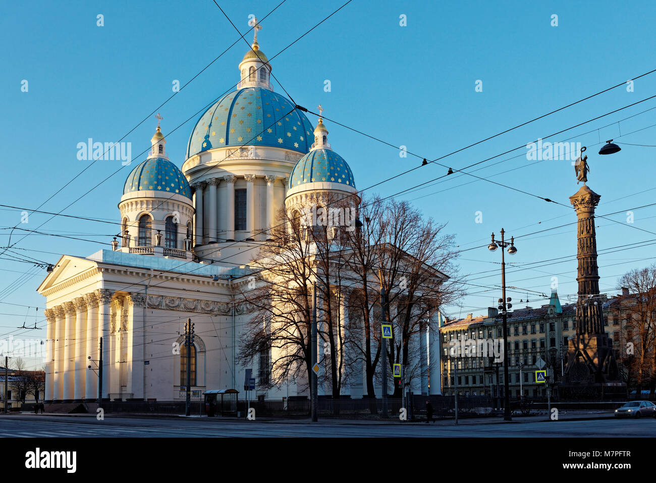 St. Petersburg, Russia - January 1, 2016: Trinity cathedral and Russo-Turkish War Memorial column in a winter day. - Stock Image