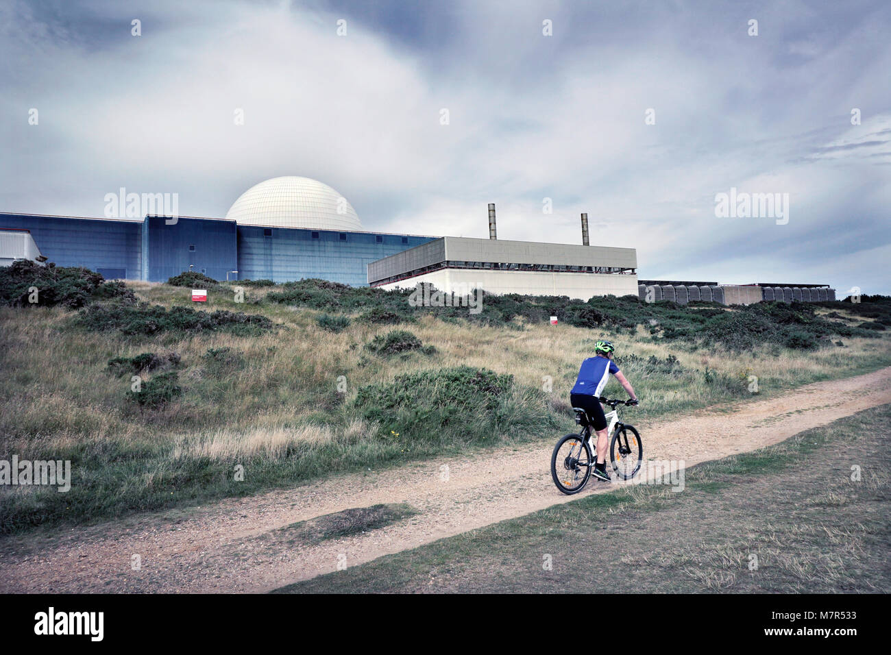 cycling past sizewell B nuclear power station sizewell suffolk england UK - Stock Image