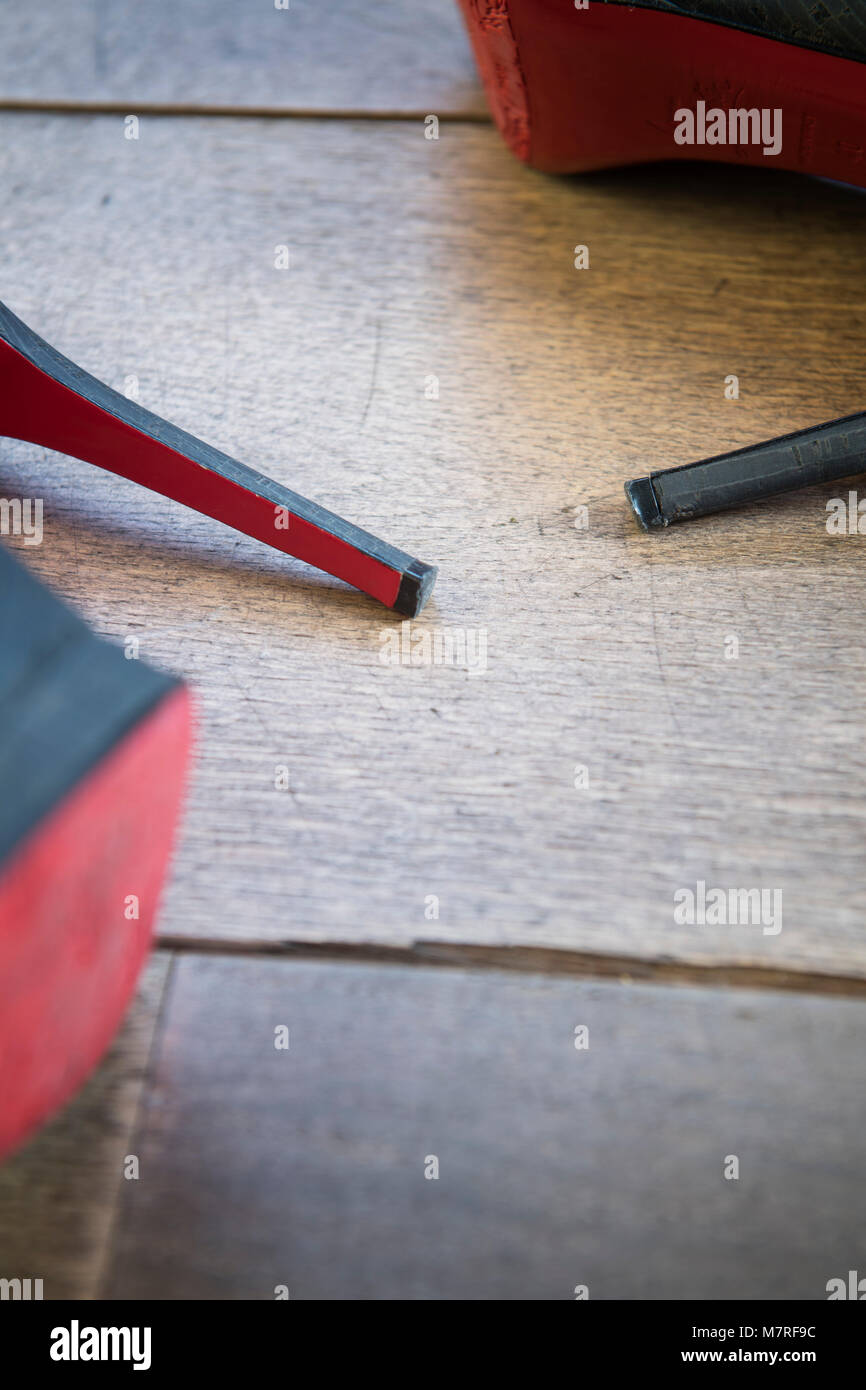 Detail of high heel ladies shoes on a wooden floor - Stock Image