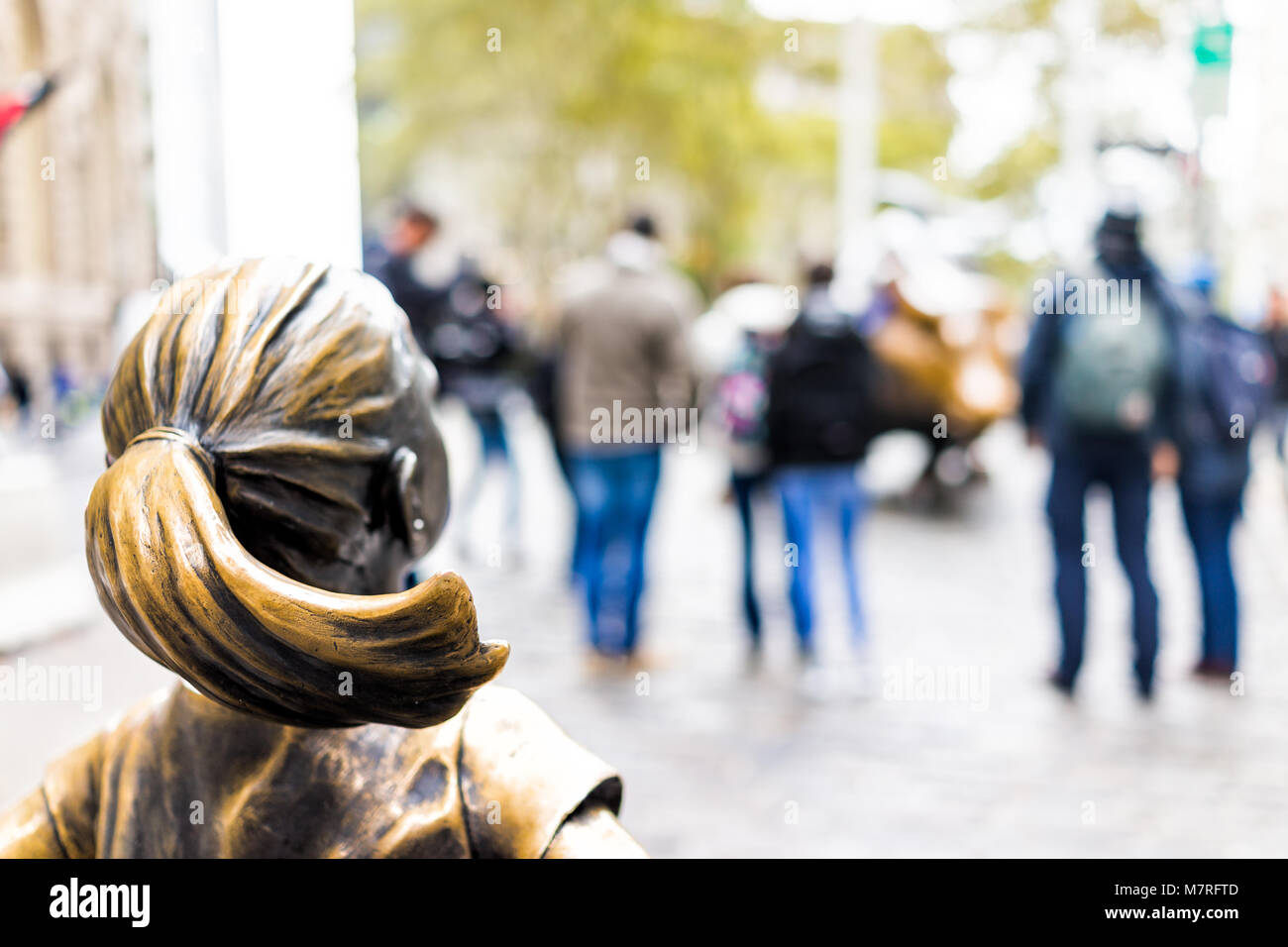 New York City, USA - October 30, 2017: Wall Street stock exchange The Fearless Girl statue facing Charging Bull - Stock Image