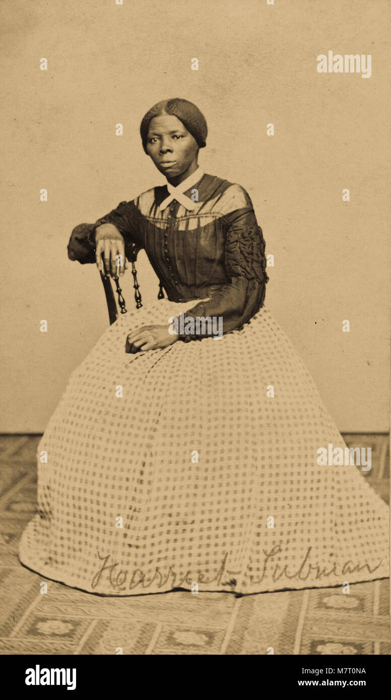 Photograph shows Harriet Ross Tubman (1820?-1913) seated in an interior room, turned to the left. One hand rests - Stock Image