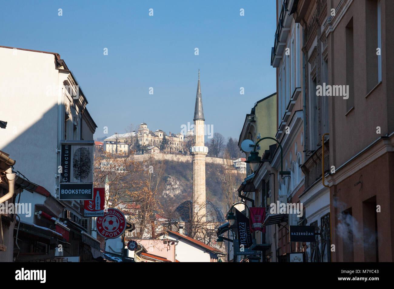 SARAJEVO, BOSNIA AND HERZEGOVINA - FEBRUARY 16, 2018: Mosque Minaret in the Bascarsija district in winter.  Bascarsija - Stock Image
