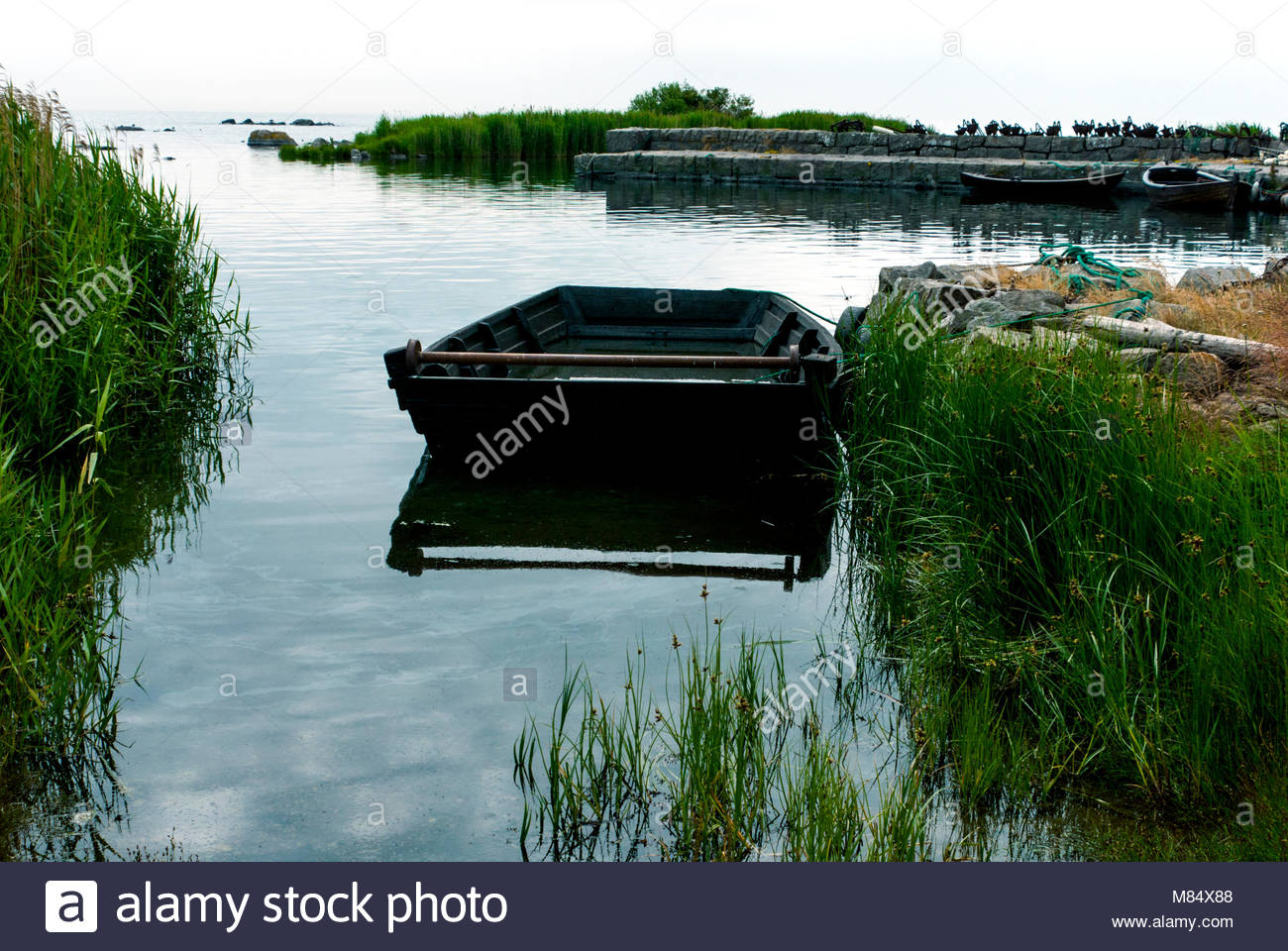 Wooden boats and old fishing gear. - Stock Image