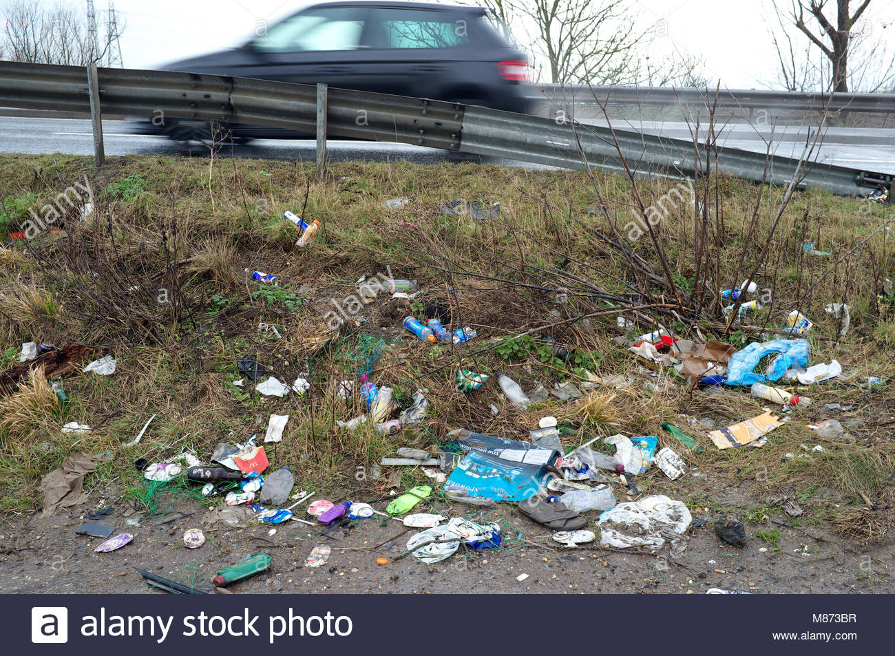 Litter - roadside rubbish discarded on the grass verge. Isle of Sheppey, Kent, UK. Stock Photo
