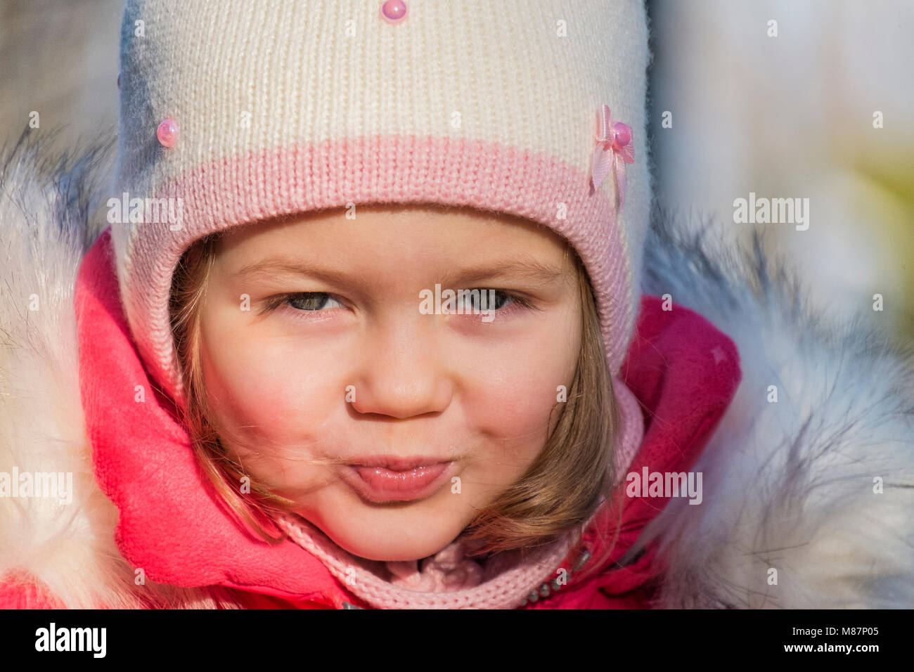 Portrait of a little girl in winter clothes - Stock Image