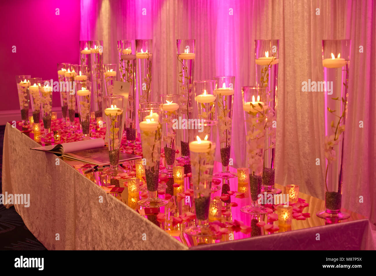 Table With Wedding Album And Display Of Floating Candles Stock Photo