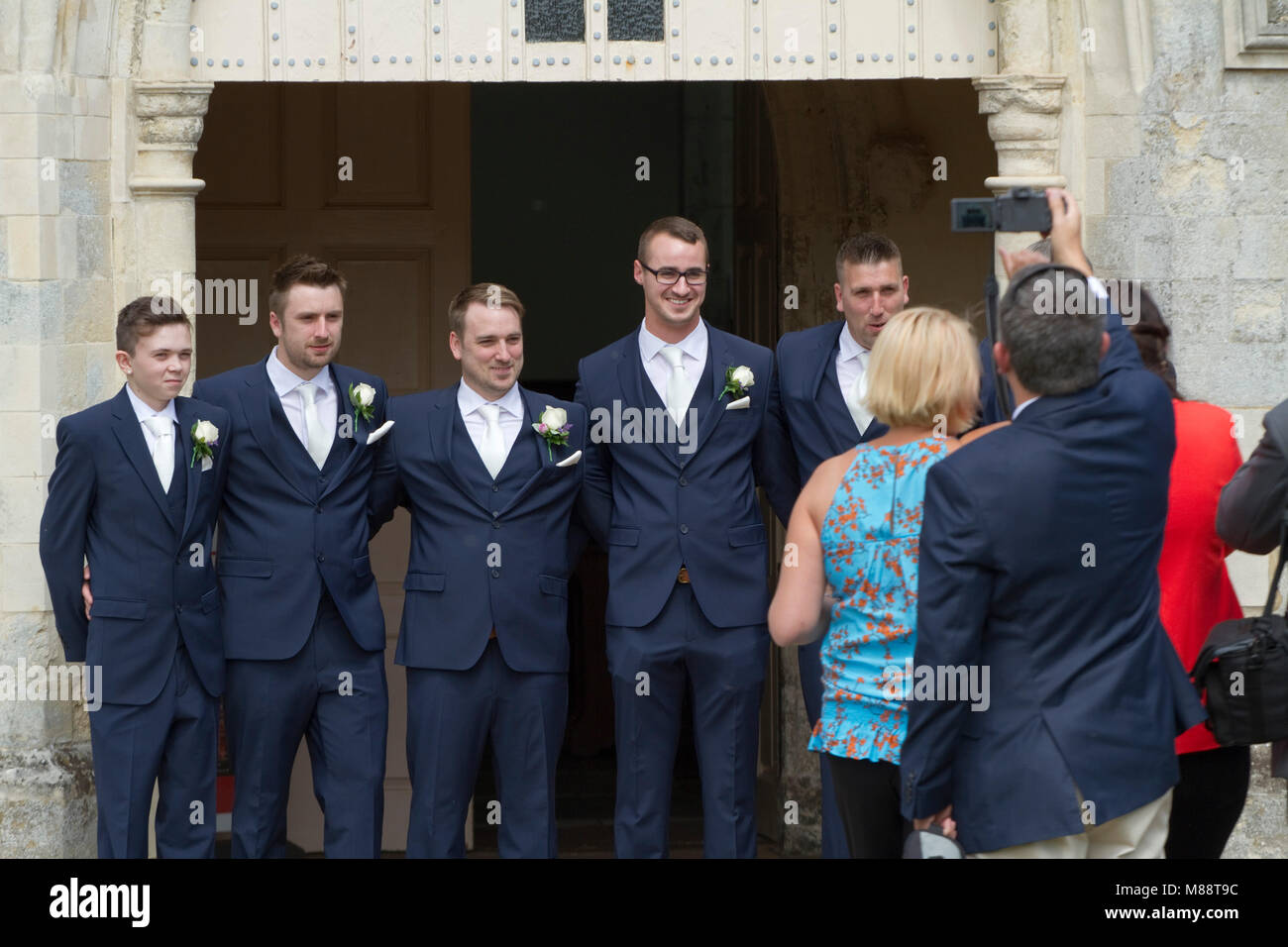 The groom's party wearing matching blue suits - Stock Image