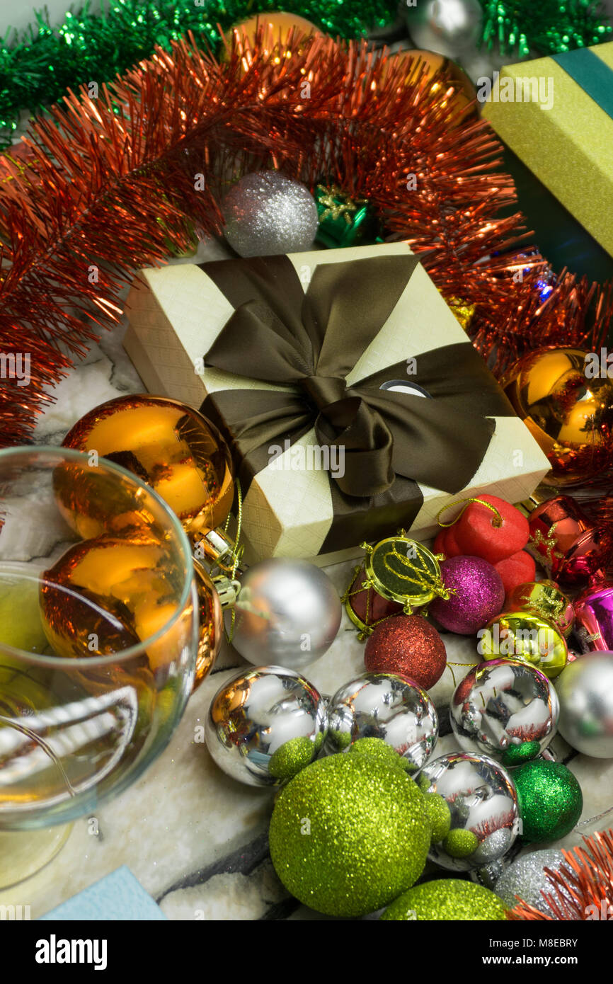 festive christmas and new year background wallpapers or cards christmas tinsel decorations gifts and other attributes of the holiday on a brown w