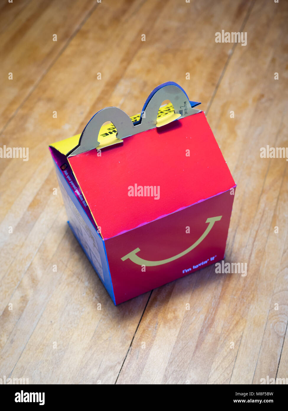 A McDonald's Happy Meal box. - Stock Image