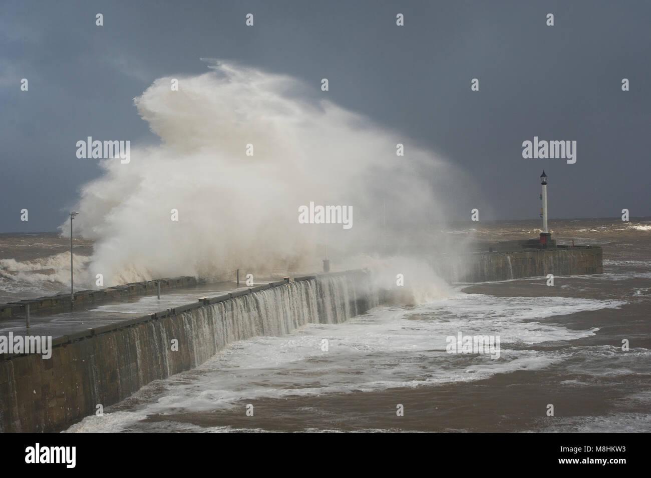 Bridlington, East Yorkshire, UK. 17th Mar, 2018. Huge waves crashing over the walls of Bridlington Harbour as the - Stock Image
