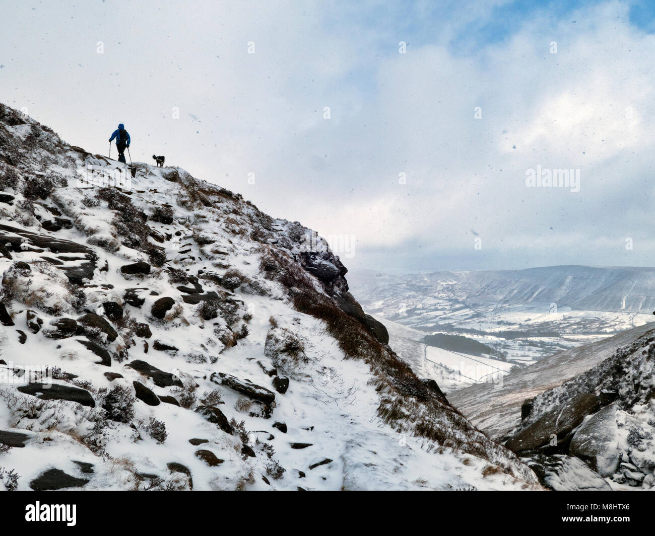 Derbyshire, UK. 17th March 2018 man walking in the Beast From The East 2 snow & Ice conditions with a Border - Stock Image