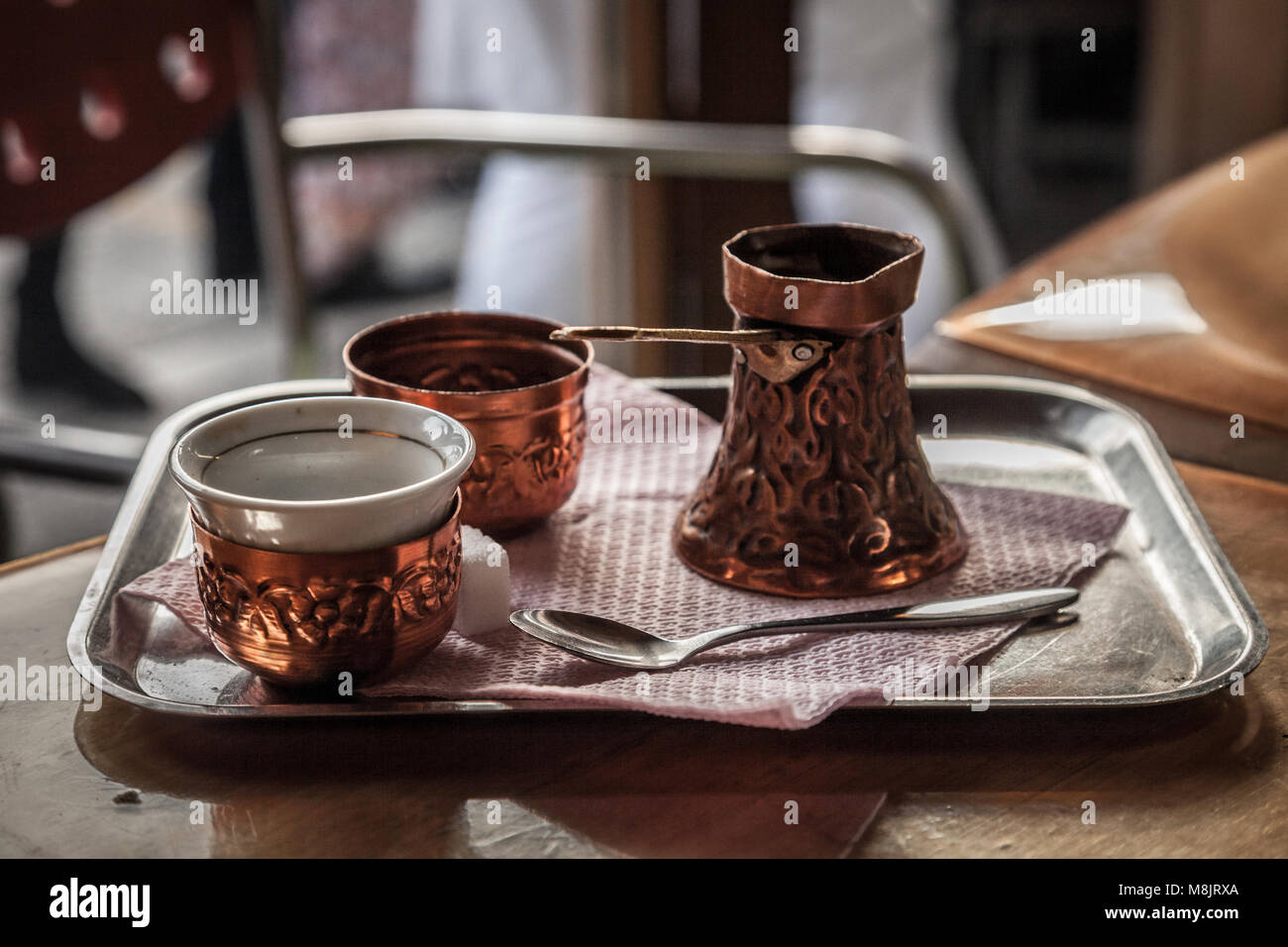Bosnian Coffee Pot, also known as Dzezva, taken in a Sarajevo Cafe. A Dzezva, or cezve is a pot designed specifically - Stock Image