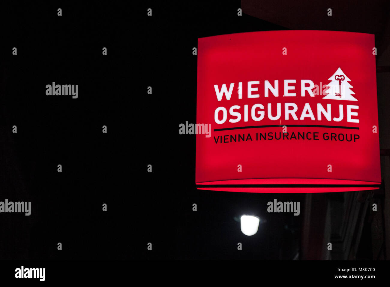 SARAJEVO, BOSNIA - FEBRUARY 16, 2018: Wiener Insurance logo on their main agency in Sarajevo, taken at night. Wiener - Stock Image