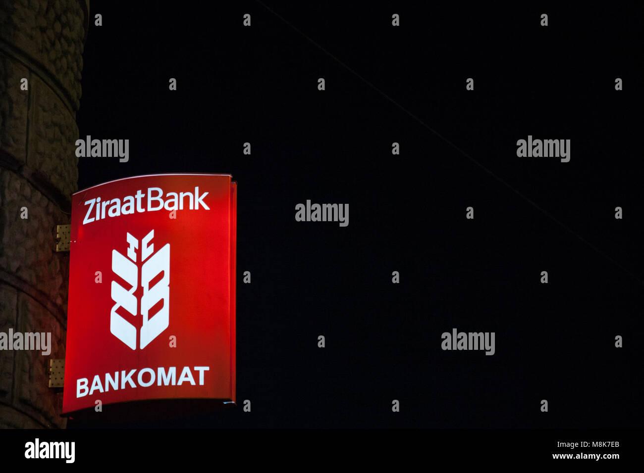 SARAJEVO, BOSNIA - FEBRUARY 16, 2018: Turkish Ziraat Bank logo on their main bank in Sarajevo, taken at night. Ziraat - Stock Image